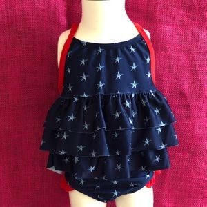 UFP 50+ Red/white/blue Swimsuit 2T